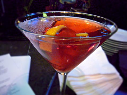 The signature cocktail - something involving Reyka, cranberry juice, and a cinnamon stick